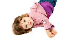 Little Girl Lying On White Floor Royalty Free Stock Image