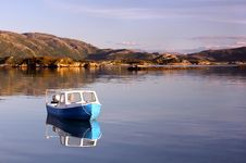 Free Lonely Small Fishing Boat In The Norwegian Fjords Stock Image - 21366881