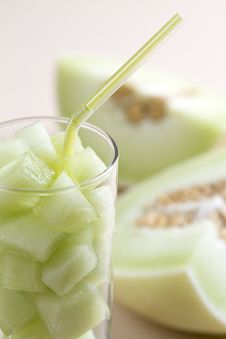 Free Green Melon Pieces In A Glass With Straw Royalty Free Stock Image - 21372566