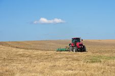 Free Tractor Working In The Field. Royalty Free Stock Image - 21379926