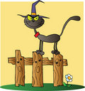 Free Halloween Witch Cat On A Fence Over Yellow Stock Photo - 21383120