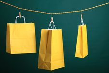 Free Shopping Yellow Gift Bags On Green Royalty Free Stock Photos - 21384658