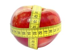 Apple And Measuring Tape Isolated On White Stock Image