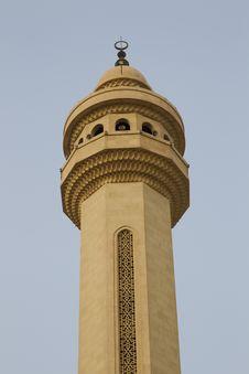 Single Minaret Against A Blue Sky Stock Photo