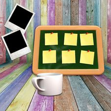Blackboard And Coffee Mug On Vivid Wooden Shelves Royalty Free Stock Image