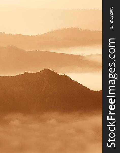 Foggy panorama at sunset