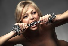 Free Angry Woman Biting A Chrome Chain Royalty Free Stock Photo - 21394035
