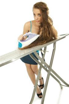 Free Woman Ironing Her Hair Stock Photo - 21394070