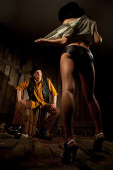 Free Cowboy Looking At Striptease Woman Royalty Free Stock Photo - 21394085