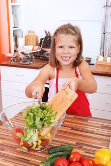 Free Girl Making Salad Royalty Free Stock Photo - 21394465