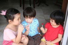 Free Kids Eating Lollipop Stock Photos - 2140033