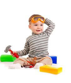 Little Boy With Building Blocks And Tools Royalty Free Stock Image