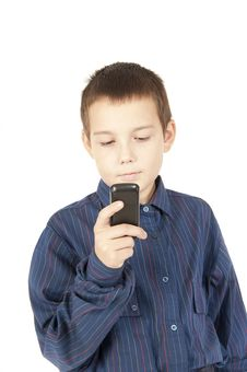 Free The  Teenager Looks At A Mobile Phone Stock Photography - 21413662