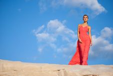 Beauty Woman In Red Dress On The Desert Stock Photography