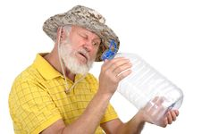 Free Senior Man Looking Into Empty Bottle Royalty Free Stock Photography - 21426577