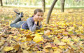 Free Girl Lying On Fall Leaves Outdoors Royalty Free Stock Image - 21432466