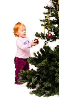 Free A Little Girl Decorates A New-year Tree Stock Image - 21439891