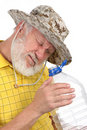 Free Senior Man Looking Into Empty Bottle Royalty Free Stock Photography - 21441047
