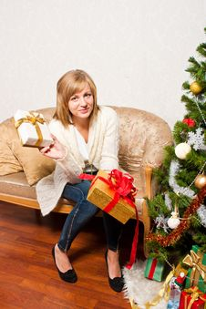 Free Young Woman Near A Fir-tree Royalty Free Stock Photography - 21440117
