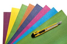 Free Knife For A Paper On Sheets Of A Color Paper Royalty Free Stock Images - 21440489