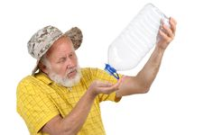 Free Senior Man With Empty Plastic Bottle Stock Images - 21441044