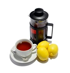 Free Cup Of Tea, Kettle And Three Lemons Stock Photo - 21441430
