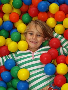 Free Young Girl In Fun Balls Royalty Free Stock Image - 21453526