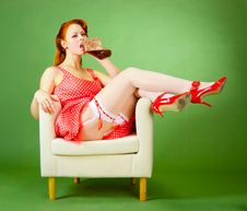 Free Pin-up Style Girl Sitting On The Chair Royalty Free Stock Photo - 21454885