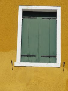 Green Shuttered Window In Yellow Wall Royalty Free Stock Photos