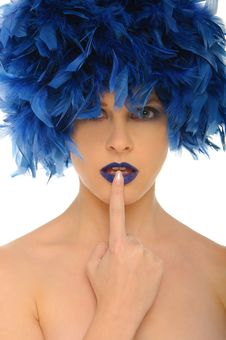Woman With Blue Feathers Lips And Open Eyes Royalty Free Stock Photography