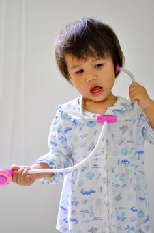 Portrait Cute Kid With Stethoscope Toy Royalty Free Stock Image