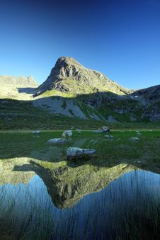 Free Tall Mountain Peak Reflected, Troms County, Norway Royalty Free Stock Images - 21459899