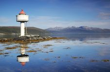 Free Little White Lighthouse In The Norwegian Fjords Stock Image - 21459921