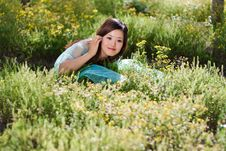 Free Young Beautiful Girl Laying On The Flowers Field Royalty Free Stock Photography - 21461377