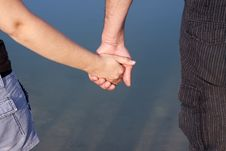 Free Couple Hands Over Blue Lake Royalty Free Stock Image - 21468096