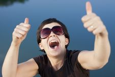 Free Young Brunette Girl Thumbs Up Stock Photography - 21468102