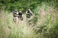 Free Rebel Soldiers On Patrol Stock Photography - 21469902