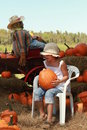 Free Girl In A Halloween Pumpkin Patch Stock Photos - 21470223