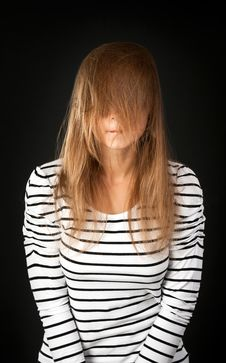 Hair Covers Her Face With A Young Girl Royalty Free Stock Photography