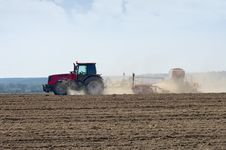 Tractor Working In The Field. Stock Photography