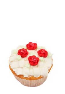 Vanilla Cupcake With Basketweave Icing And Roses Royalty Free Stock Images