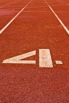 Number Four On The Start Of A Running Track Stock Photos