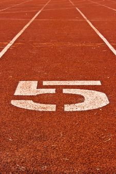 Number Five On The Start Of A Running Track Stock Photo