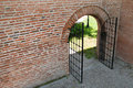 Free Opened Iron Forged Gate With Brick Wall Stock Photography - 21494452