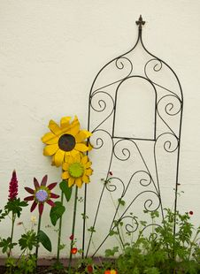 Free Metal Flowers And Trellis Against A White All. Stock Image - 21493321