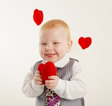 Free Baby Boy With A Soft Red Heart In Hands Royalty Free Stock Photography - 21499967