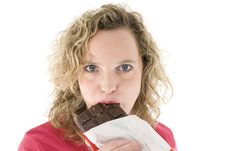 Free Blonde Eats Chocolate Royalty Free Stock Image - 2153616