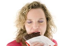 Free Blonde Eats Chocolate Stock Photos - 2153653