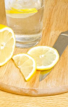 Free Sliced Lemon On Chopping Board Stock Photos - 21516753