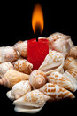 Free Romantic Candle Against The Shells. Stock Photos - 21528623